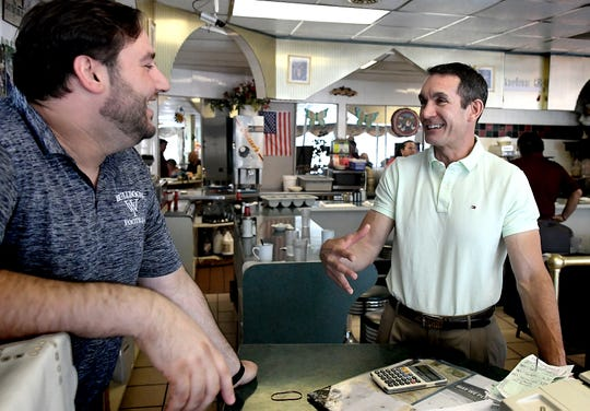 State Auditor General Eugene DePasquale talks with Astoria Diner owner Sam Margetas, left, at the restaurant in West York Monday, July 1, 2019. DePasquale announced his bid for U.S. House seat at the diner, challenging Rep. Scott Perry in 2020. Bill Kalina photo