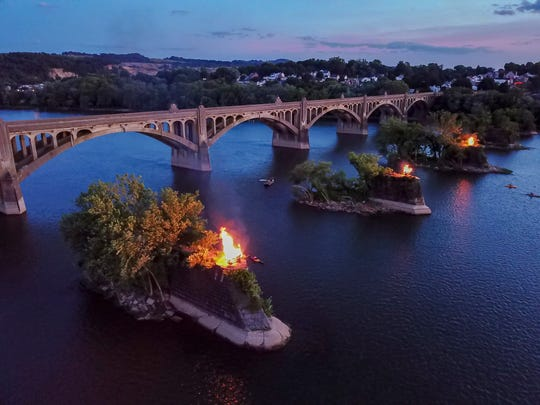Fires are lit on three of the piers of the old Columbia-Wrightsville bridge during the 17th annual Riverfest sponsored by Rivertown PA USA, Sunday, June 30, 2019. Union troops retreating from York burned the bridge to keep Confederate troops from reaching Philadelphia during the Civil War in 1863.