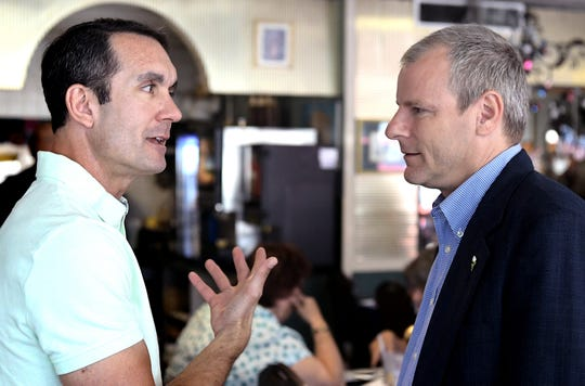 State Auditor General Eugene DePasquale, left, talks with York City Mayor Michael Helfrich at the Astoria Diner Monday, July 1, 2019. DePasquale announced his bid to challenge Rep. Scott Perry in for a House seat 2020. Bill Kalina photo