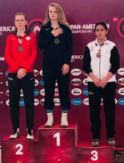 Stewartstown's Tiffani Baublitz stands atop the victory podium after winning the 69-kilogram (152-pound) title at the Cadet Pan American Championships in Mexico over the weekend.
