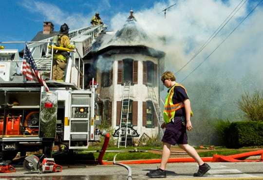 Firefighters work to put out a fire at the Christmas Haus on Lincoln Way West in New Oxford in April 2010.