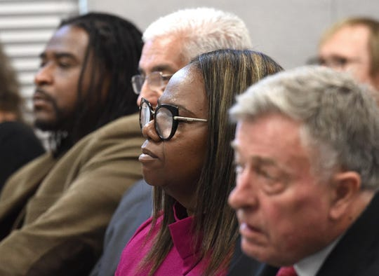 Traci Davis listens at school board meeting on July 1, 2019.