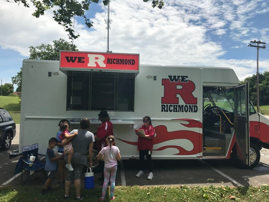 Brown hands out meals from the RCS Food Truck at Clear Creek Park