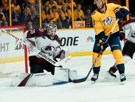 Nashville Predators center Colton Sissons (10) watches as a shot hits Colorado Avalanche goaltender Andrew Hammond (35) during the second period in Game 5 of an NHL hockey first-round playoff series Friday, April 20, 2018, in Nashville. Hammond has signed with Buffalo and will likely start the season as the Amerks goaltender.