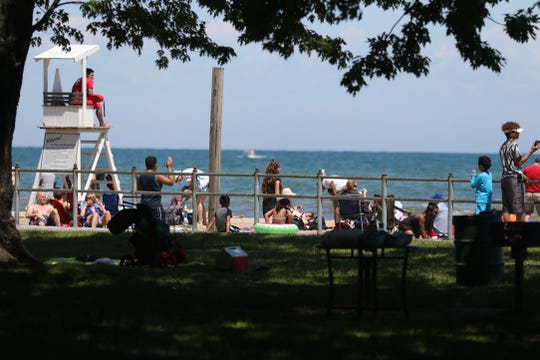 Sunbathers and swimmers at Ontario Beach Park, July 2017