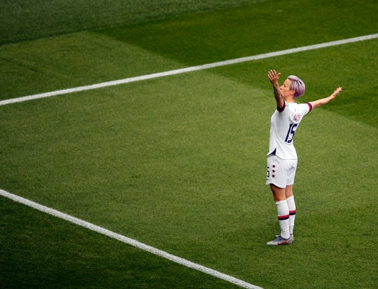 United States' Megan Rapinoe celebrates after scoring her side's first goal during the Women's World Cup quarterfinal soccer match between France and the United States at the Parc des Princes, in Paris, Friday, June 28, 2019. (AP Photo/Francois Mori)