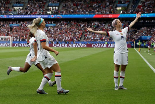 United States' Megan Rapinoe, right, celebrates after scoring her team's first goal during the Women's World Cup quarterfinal soccer match between France and the United States at Parc des Princes in Paris, France, Friday, June 28, 2019. (AP Photo/Alessandra Tarantino)