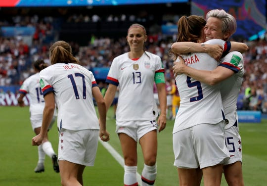 United States' Megan Rapinoe, right, celebrates with teammates after scoring her team's firs goal during the Women's World Cup quarterfinal soccer match between France and the United States at Parc des Princes in Paris, France, Friday, June 28, 2019. (AP Photo/Alessandra Tarantino)