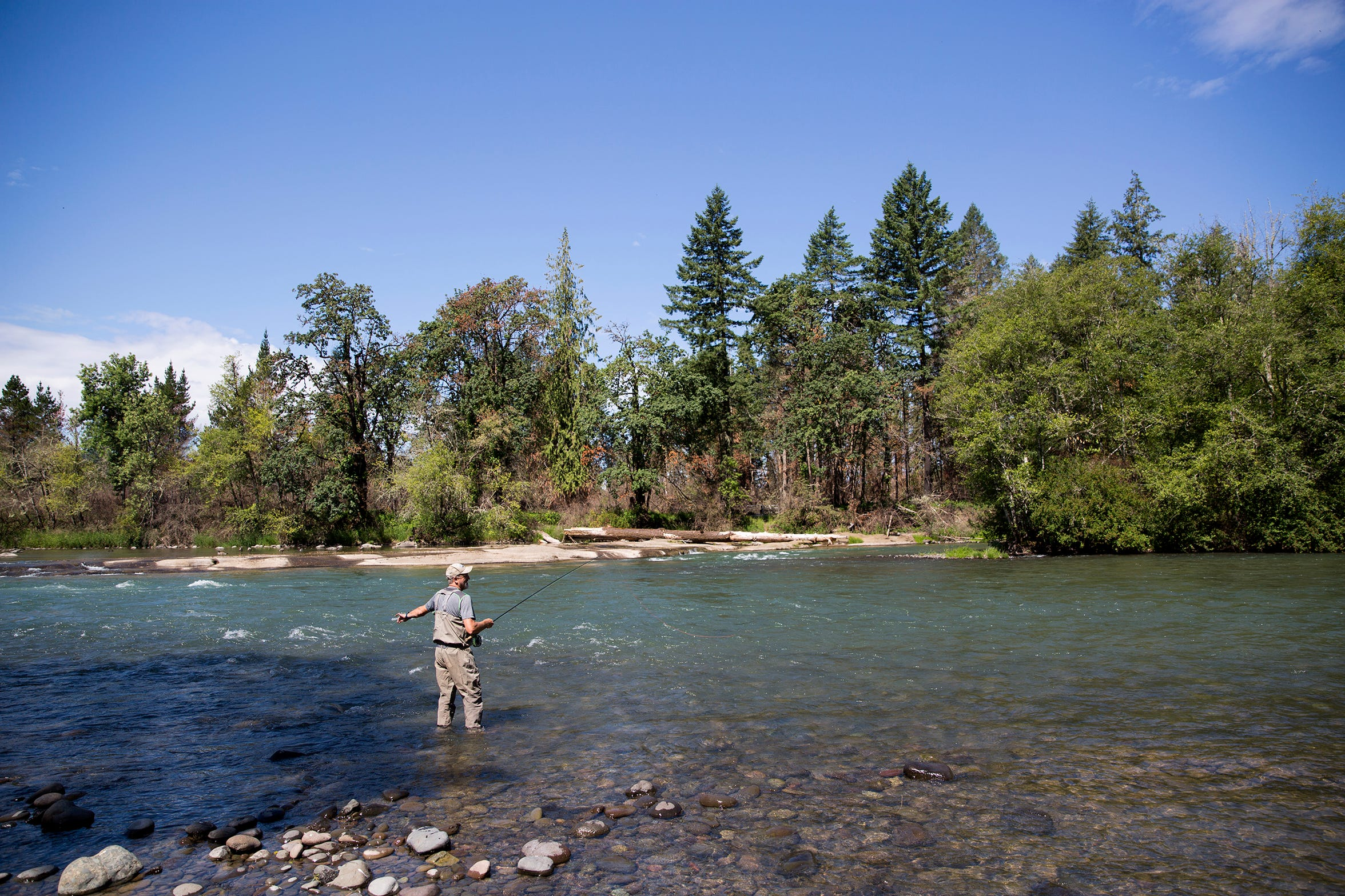 Dave Carpenter, a former fishing guide on the North Santiam River and long-time advocate for native fish, casts his fishing rod at North Santiam State Recreation Area in Lyons on June 26, 2019.