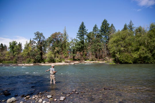 Dave Carpenter, a former fishing guide on the North Santiam River and long time advocate for native fish, casts his fishing rod at North Santiam State Recreation Area in Lyons on June 26, 2019.