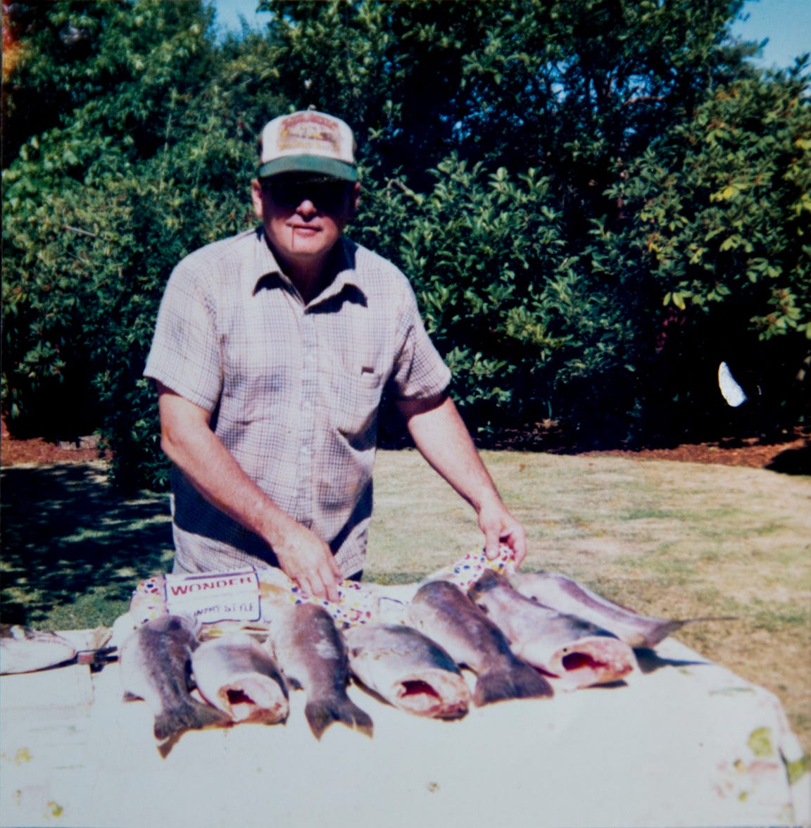 Bob Lusk, a long-time angler and shuttle driver on the North Santiam River, is pictured in 1986 with his fish he caught.
