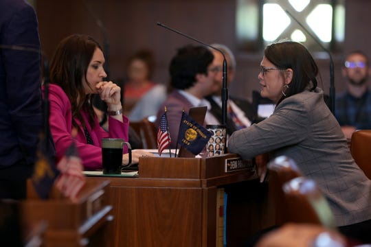 Sen. Sara Gelser, D-Corvallis, and Sen. Shemia Fagan, D-Portland, speak to each other on the last day of the 2019 legislative session at the Oregon State Capitol in Salem on June 30, 2019.