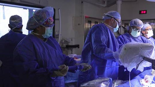 A team at Shannon Medical Center performs a transcatheter aortic valve replacement. The minimally invasive procedure provides an alternative to traditional open-heart surgery.