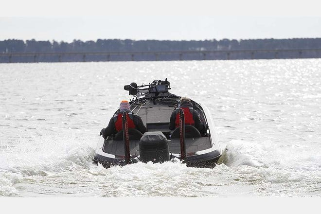 Two collegiate anglers race across Sam Rayburn Reservoir looking for a productive site.