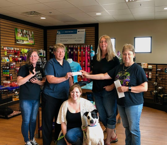 Carla Michel (right center) and Amy Gaikowski (left center) helped raise more $3,000 for the Sioux Falls Humane Society as part of their end of the season plant rescue.