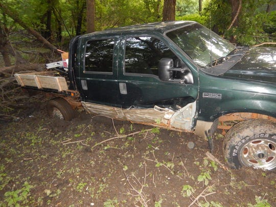 Authorities located the man and his vehicle in a tree grove in Chautauqua Park, where he was actively trying to get his truck unstuck from the mud.
