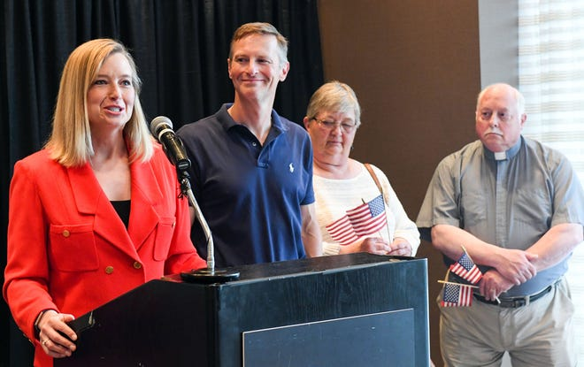 Scyller Borglum is joined by her husband, Tim Masterlark, and parents, Susan Borglum and Rev. Kent Borglum, as she announces her campaign for a Senate seat Monday, July 1, at the Hilton Garden Inn in Sioux Falls.