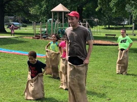 News-Leader reporter Harrison Keegan leads the field in a recent Run for Fun gunny-sack race at Hailey Owens park.