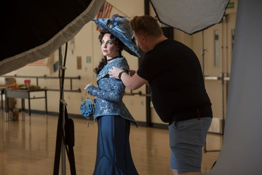 Daniel Koye, right, puts finishing touches on a Tuacahn actress' hair and costuming during a photo shoot on Thursday, June 27, 2019.