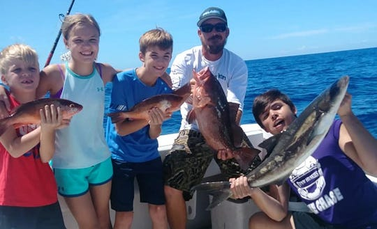 Snapper, grouper and cobia were on the catch list for these kids aboard Little Adam charters in Fort Pierce Monday.