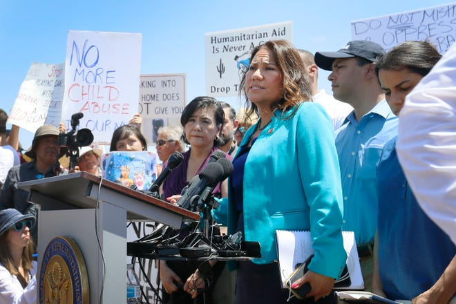 U.S. Rep. Veronica Escobar, D-El Paso, a member of the House Judiciary Committee and freshman representative of the Hispanic Caucus, talks about what she saw on her tour of area border facilities Monday, July 1, 2019, at the Border Patrol station in Clint. Escobar  was attempting to talk over protesters.