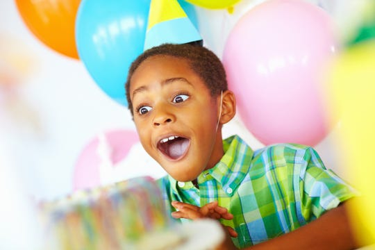 A child is surprised with a birthday gift.