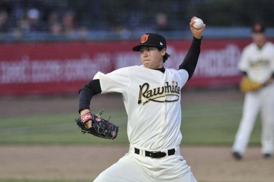 Tyler Skaggs (11) pitches for the Visaila Rawhide against the Bakersfield Blaze on Friday, April 8, 2011.