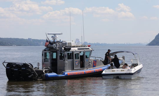 Westchester County Police Marine Unit patrols pulls over a boat that was going to fast under the Mario M. Cuomo bridge on the Hudson River near Tarrytown on July 1, 2019.  Westchester County Executive George Latimer reminds residents of boating safety regulations before the 4th of July holiday weekend.