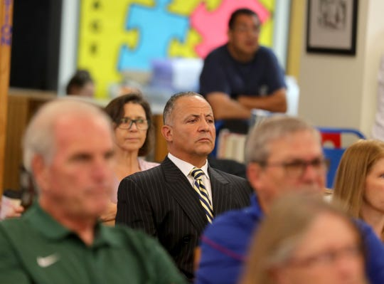Long time North Salem High School athletic director Henry Sassone listens to supporters speak on his behalf during a meeting of the North Salem school board July 1, 2019. Supporters of Sassone spoke during the public comments session of the meeting about the school district's plan to fire him.