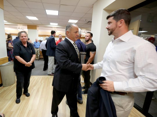 Long time North Salem High School athletic director Henry Sassone, left, greets supporter Mike DePaoli, a 2003 graduate of North Salem High School after supporters of Sassone spoke during a meeting of the North Salem school board July 1, 2019. Supporters of Sassone spoke during the public comments session of the meeting about the school district's plan to fire him.