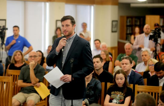 Marc Miller, a 2008 graduate of North Salem High School, speaks on behalf of long time North Salem High School athletic director Henry Sassone during a meeting of the North Salem school board July 1, 2019. Supporters of Sassone spoke during the public comments session of the meeting about the school district's plan to fire him.