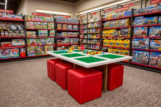 "The children's section – with a LEGO activity table and dedicated storytime space – creates a special environment for Barnes & Noble's youngest customers. A whimsical ""jungle gym"" display feature, built specially for toys, adds a sense of fun to the space."