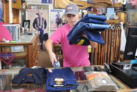 The Browse Shop owner Megan Ermis works the counter as customers shopped the store's closing sale. The Browse Shop announced on Facebook that after 51 years, they would be closing and thanked their customers for all of the generations of loyalty.