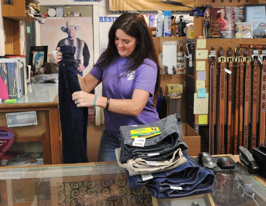 "The Browse Shop, manager Jessica Amy works to organize the store after announcing Friday that the store will be closing after 50-years of selling western wear and apparel. Amy said, ""It's nothing financial, it's just time."""