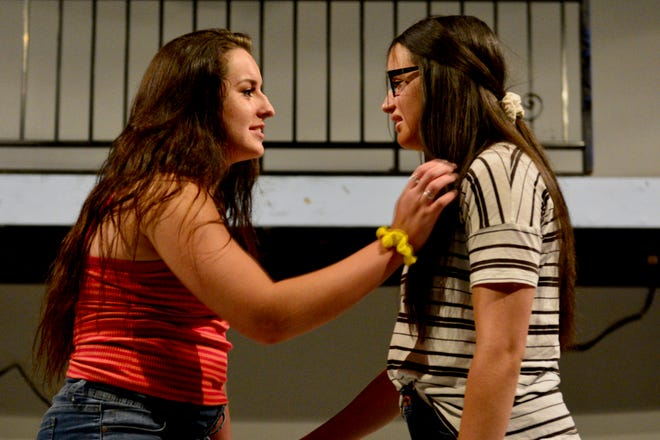 """Ellie (Alyssa Minuto) and Katherine (Angelica Concepcion) in """"Freaky Friday,"""" the story of a mother and daughter changing places, continues at 7:30 p.m. Fridays and Saturdays through July 27 on the Backdoor Theatre Main Stage as Backdoor's 52 annual Summer Youth Musical."""