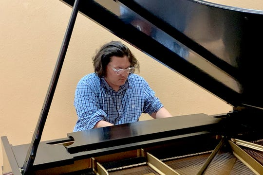 A summer intern at the Kemp Center for the Arts, Daniel Robertson plays his own classically oriented music compositions on piano in the Great Hall four days a week from 1:30 to 3:30 p.m. through early August. Robertson is currently studying psychology and would like to work as a music therapist.