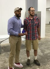 Lt. Gov. Mandela Barnes (left) presented the Energy Efficiency Excellence Award to Joe Langmeier on Monday, June 24.