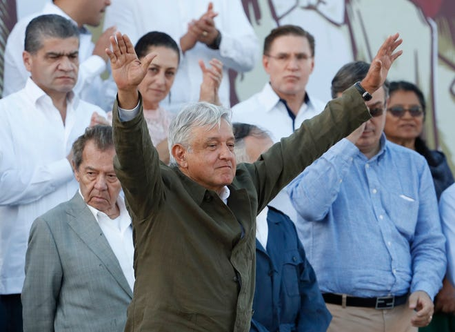Mexican President Andres Manuel Lopez Obrador receives the applause of the crowd during a rally in Tijuana, Mexico.