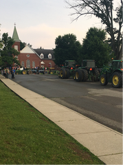 Farmers from the area drove about 30 tractors to a vigil at Grace Lutheran Church to support Tristin Boring. His two favorite tractors, a Ford 5000 and Ford 7000, were parked directly in front of the church.