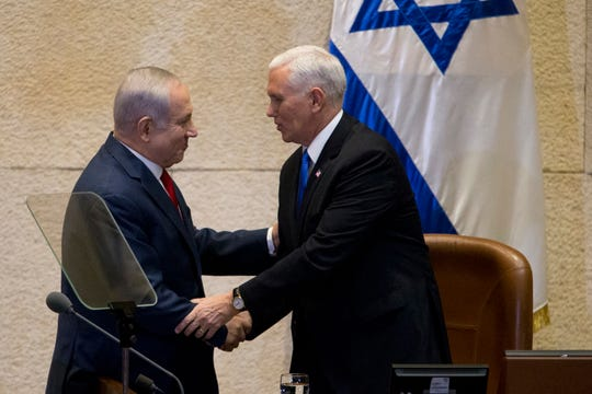 Israel's Prime Minister Benjamin Netanyahu, left, shakes hands with U.S. Vice President Mike Pence in Israel's parliament in Jerusalem, Jan. 22, 2018.