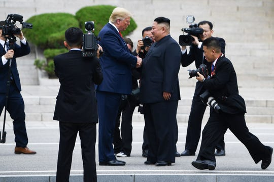 North Korean leader Kim Jong Un welcomes President Donald Trump at the Demilitarized Zone on June 30, 2019.