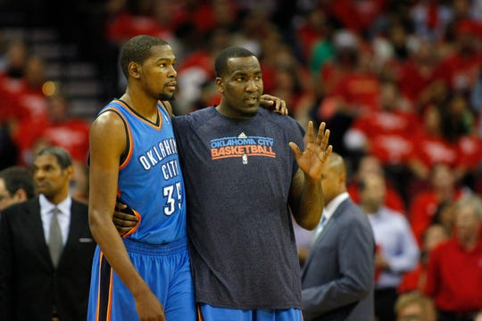 Former Oklahoma City Thunder teammates Kevin Durant and Kendrick Perkins talk during a 2013 game.