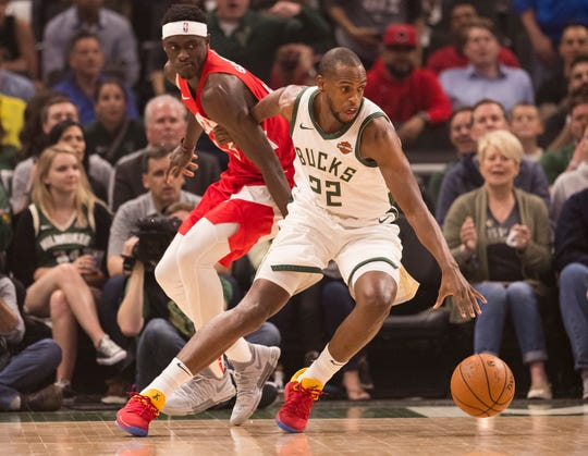 Khris Middleton will stay in Milwaukee.