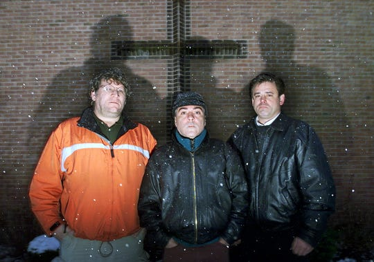 In this March 18, 2002, file photo, from left, Joe Ruggeri, Anthony Fernandes and Brian Condon stand outside of St. Lucy's Catholic Church in Middletown, R.I. All three said they were molested by Rev. James Silva when they were youth.