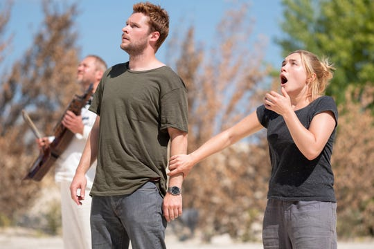 """Christian (Jack Reynor) and Dani (Florence Pugh) are horrified by what they witness – as you will be, too – in """"Midsommar."""""""