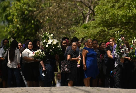 People attend the funeral of Salvadoran migrant Óscar Alberto Martínez Ramírez and his almost two-year-old daughter Angie Valeria, who both drowned while trying to cross the Rio Grande from Mexico to the United States, at La Bermeja cemetery in San Salvador on July 1, 2019.