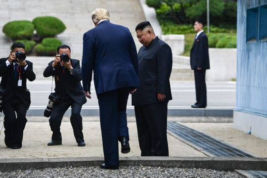 With dictator Kim Jong Un, President Donald Trump crosses the Demilitarized Zone into North Korea on June 30, 2019.