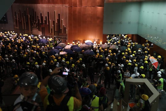 Protesters break into the Legislative Council building in Hong Kong on July 1, 2019.