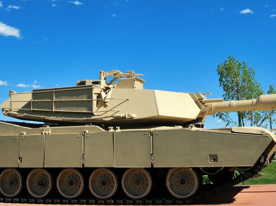 M1 Abrams tank - main battle tank - side view with sky  (unmarked vehicle, on static display outside Fort Carson Mountain Post, Colorado, USA)