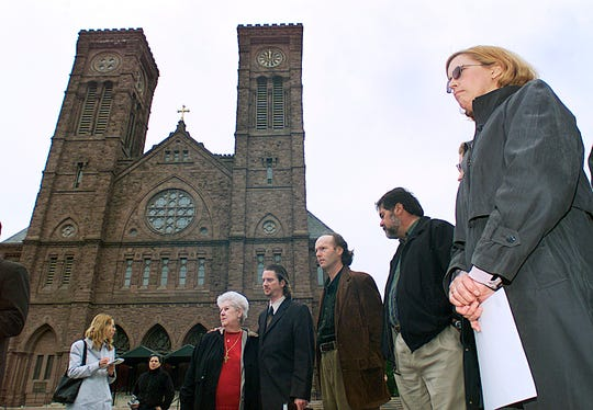 In this May 9, 2002 file photo, Phyllis Hutnak, right, prepares to speak to the media outside the offices of the Diocese of Providence in Providence, R.I. Hutnak said she was seduced by the late Monsignor Louis Dunn of St. Thomas Church in Providence when she was a teenager.